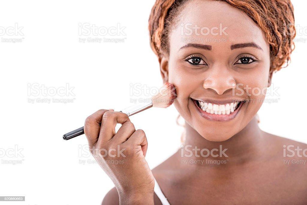 Woman using a makeup brush stock photo
