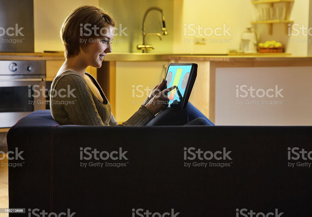 Woman using a Smart Energy Controller stock photo
