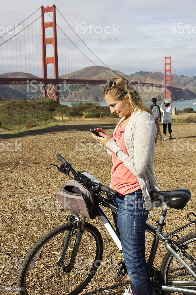 Woman using a smart phone on vacation royalty-free stock photo