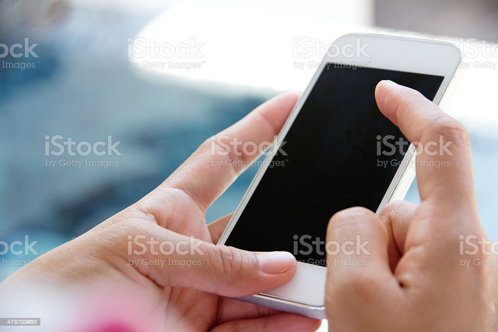 Woman Using a Smart Phone stock photo