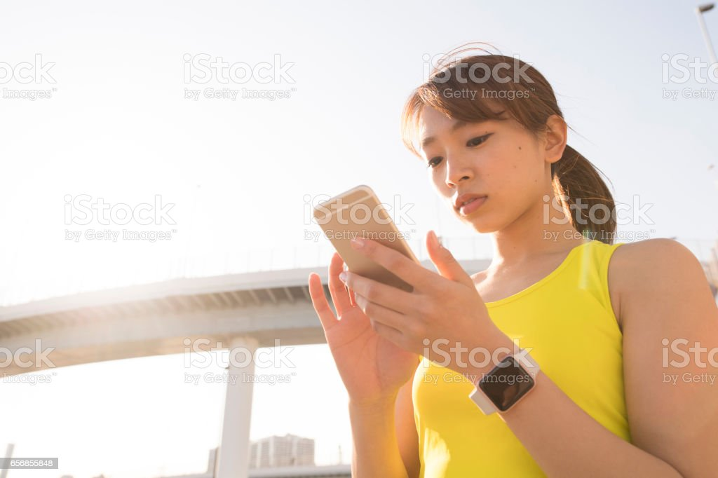 A woman using a smartphone stock photo