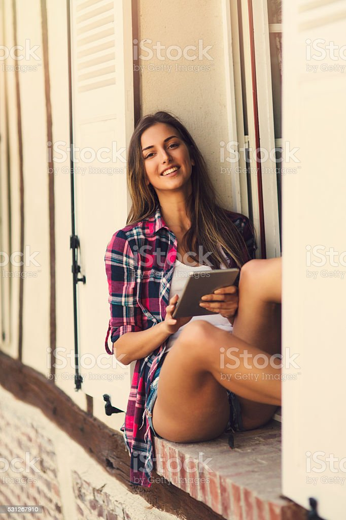 Woman using a tablet stock photo