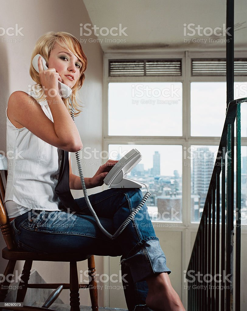 Woman using a telephone in corridor royalty-free stock photo