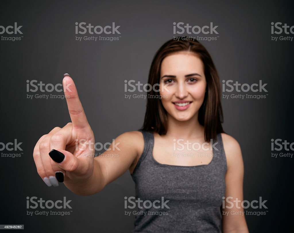 Woman using a touch screen stock photo