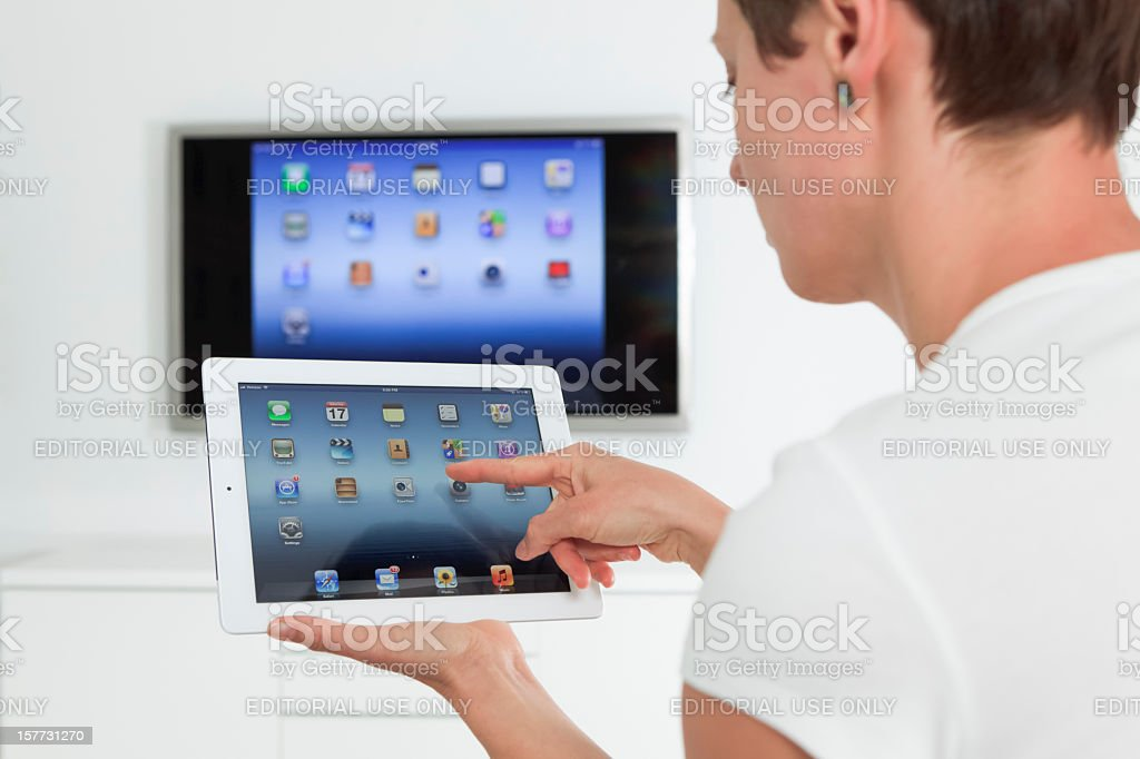 Woman using Apple Ipad 3 stock photo