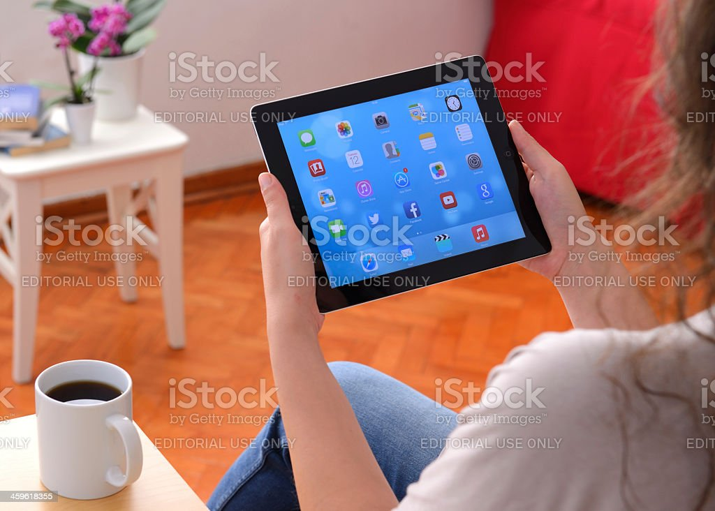 Woman using Apple iPad at home stock photo