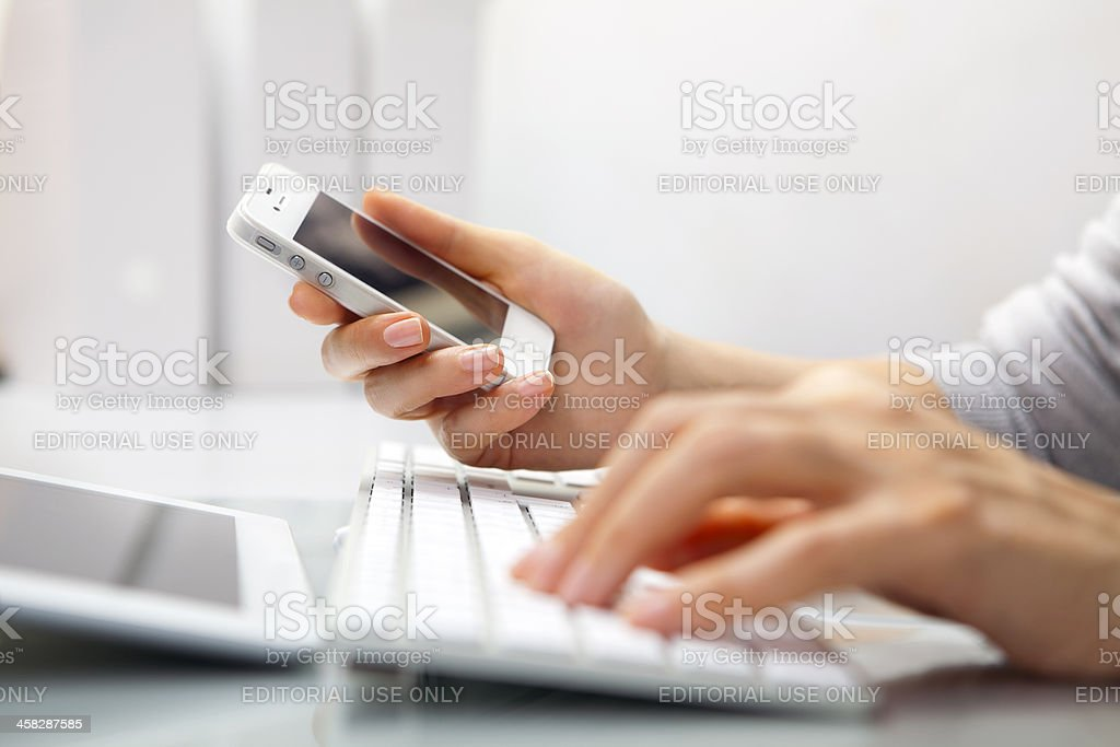 Woman using Apple products stock photo