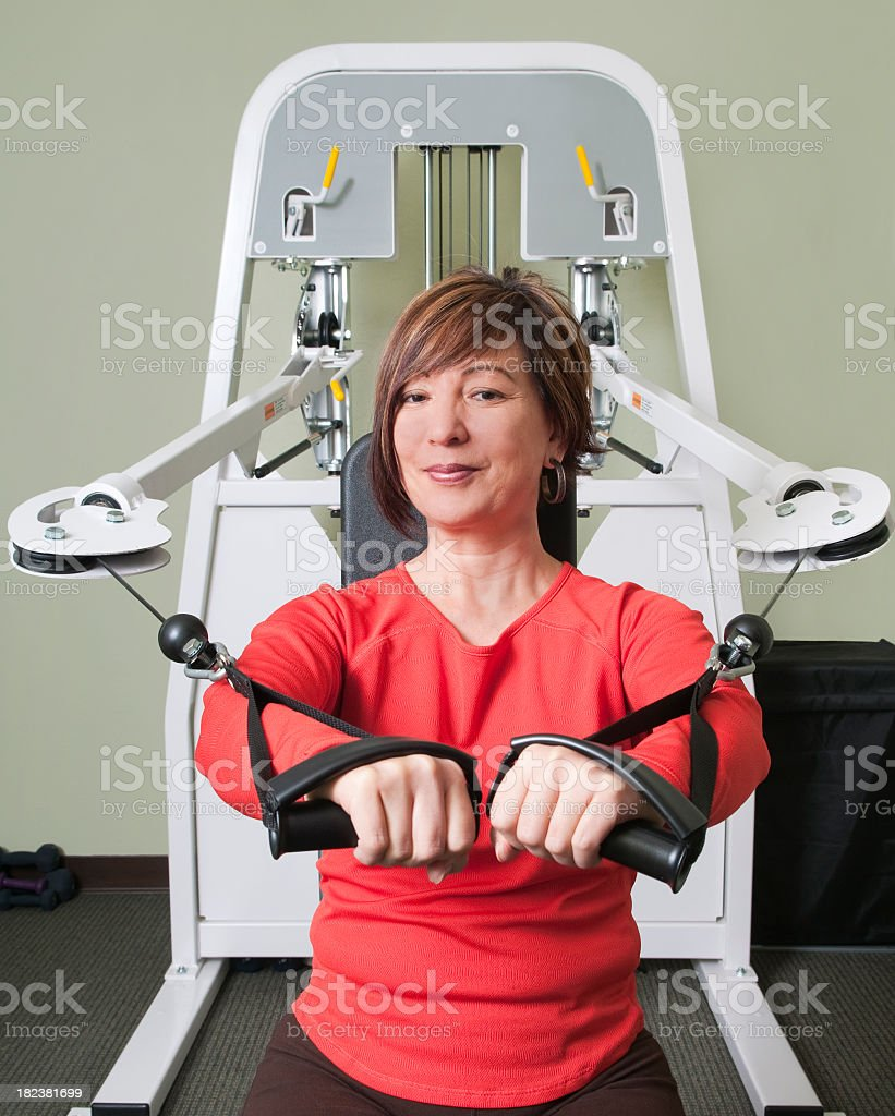 Woman Using Arm Exercise Machine for Physical Therapy royalty-free stock photo