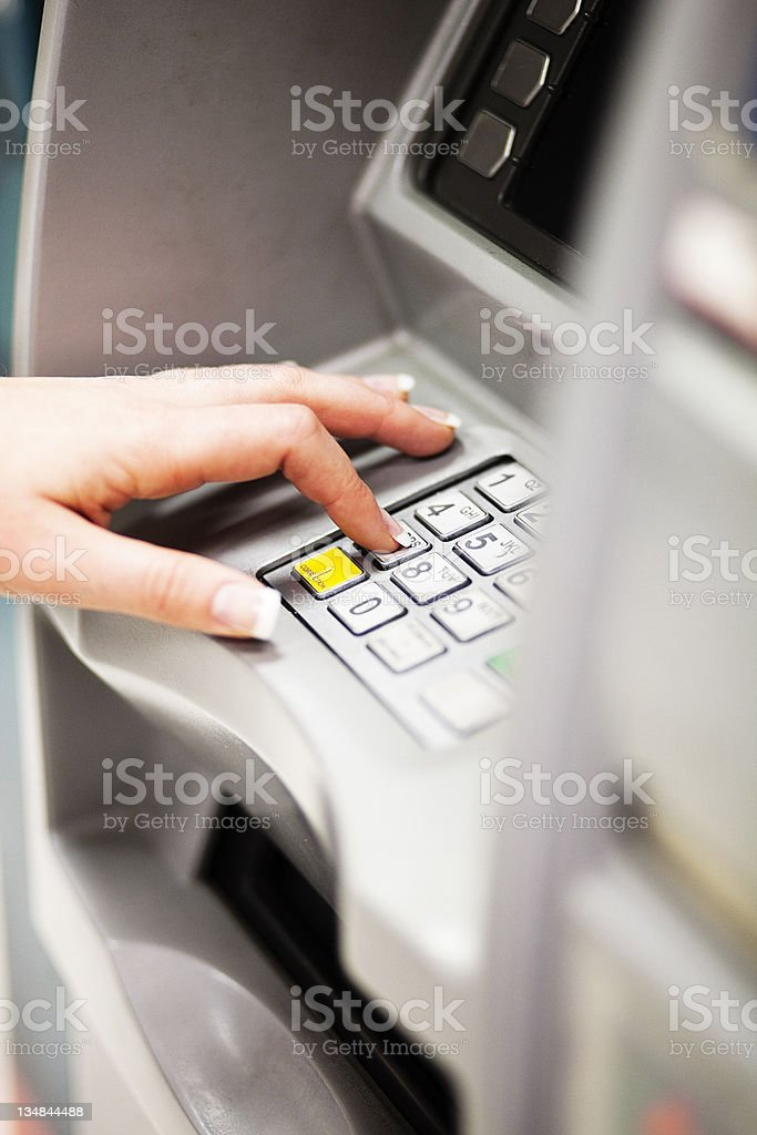 Woman using ATM royalty-free stock photo