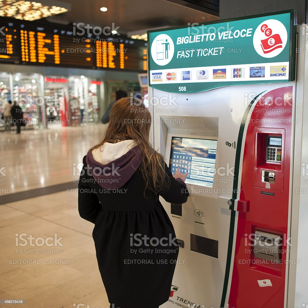 Woman Using Automated Ticket Vending Machine royalty-free stock photo