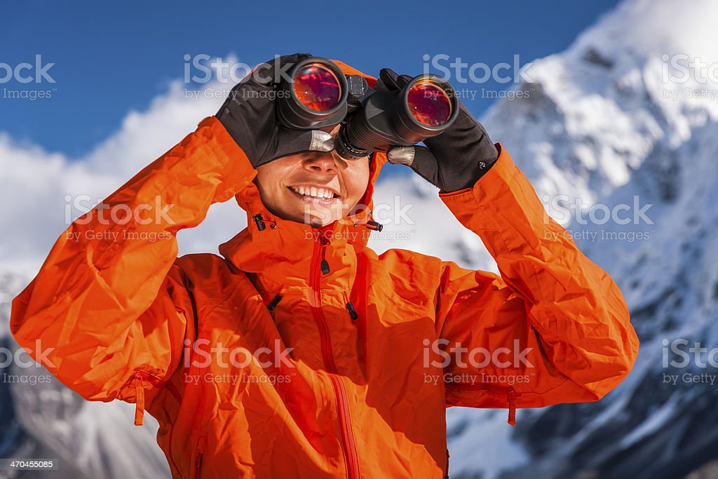 Woman using binoculars in Mount Everest National Park, Nepal royalty-free stock photo