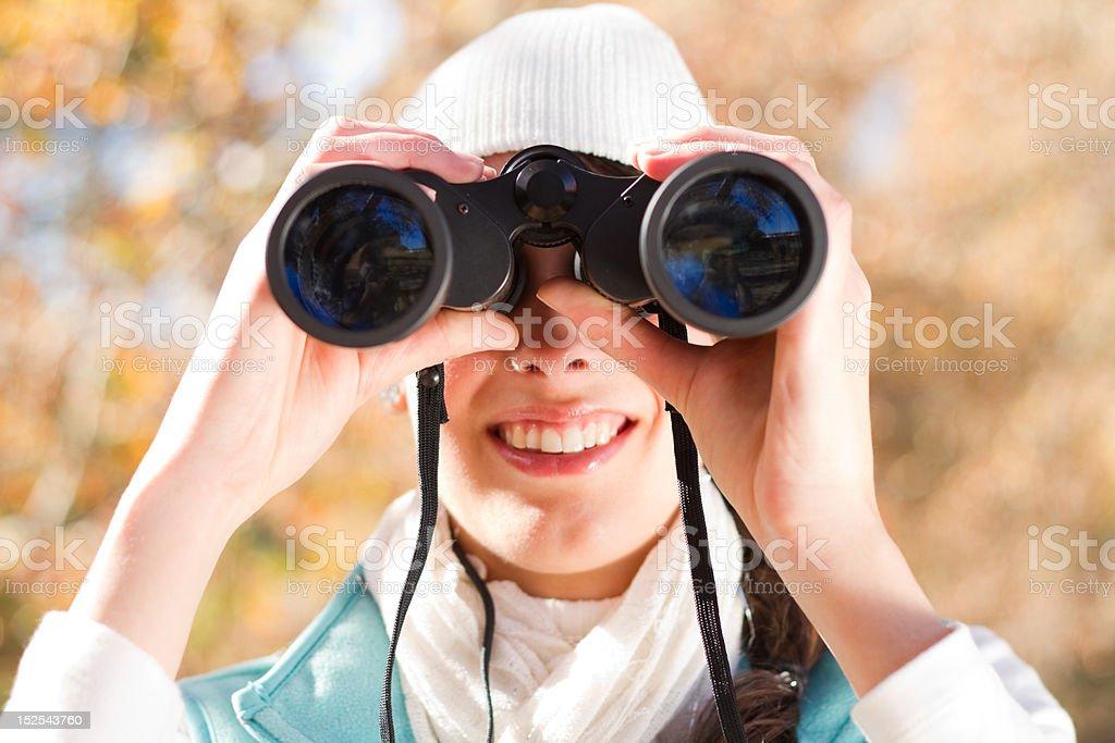 woman using binoculars outdoors royalty-free stock photo