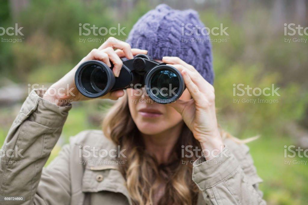 Woman using binoculars royalty-free stock photo