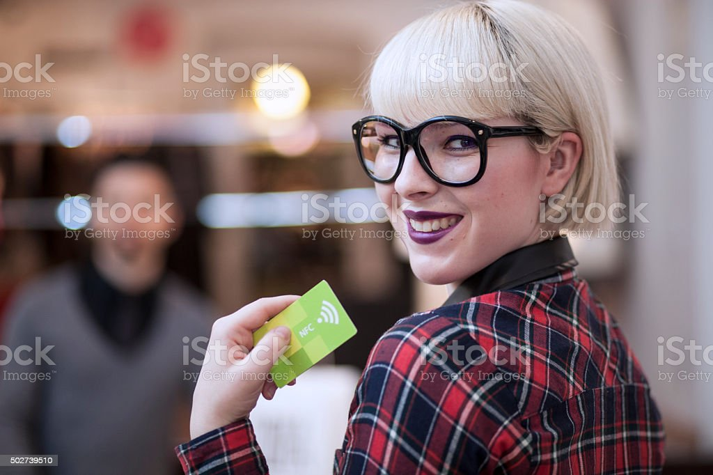 Woman using Contactless Payment stock photo