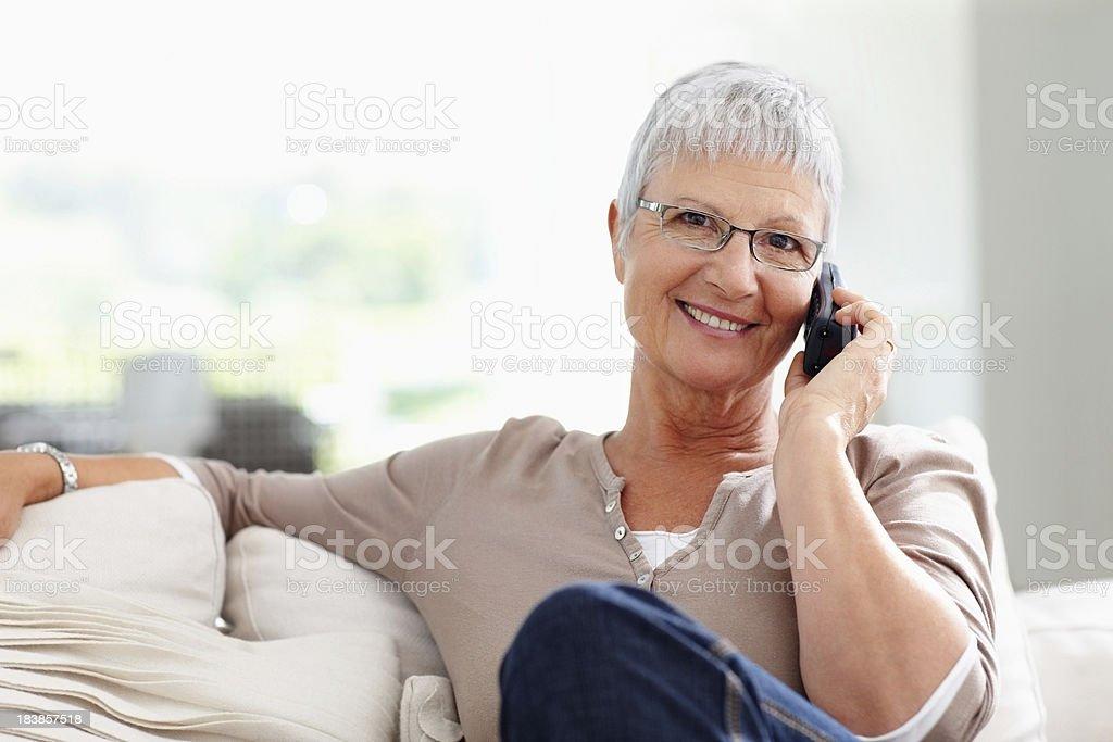 Woman using cordless phone stock photo