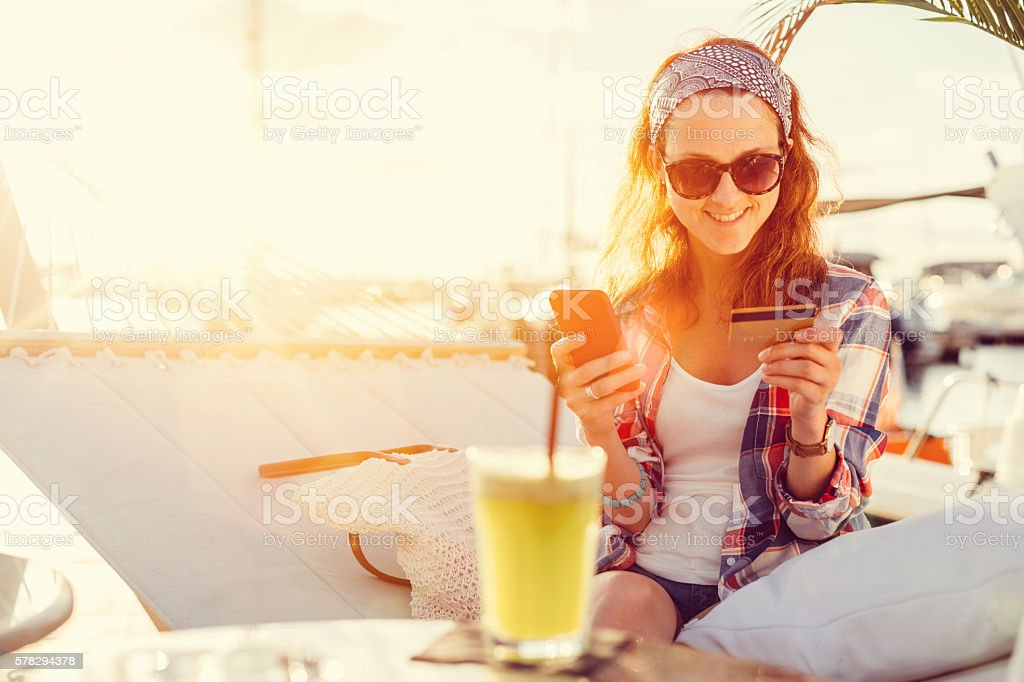 Woman using credit card on a vacation stock photo