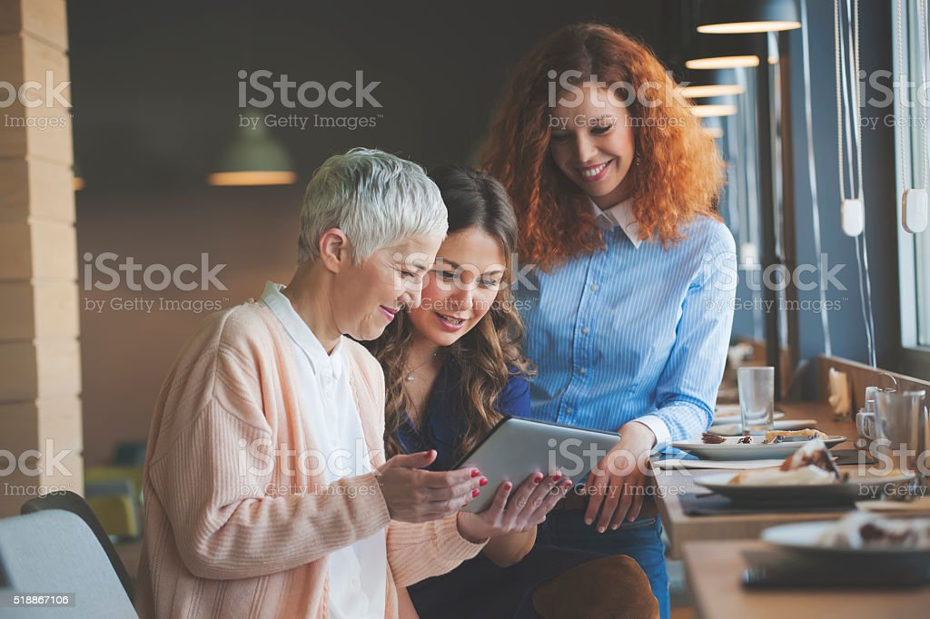 Woman using digital tablet at cafe stock photo
