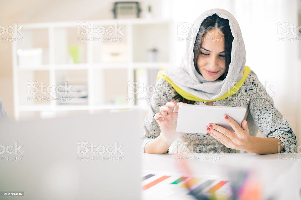 Woman using digital tablet in the office stock photo