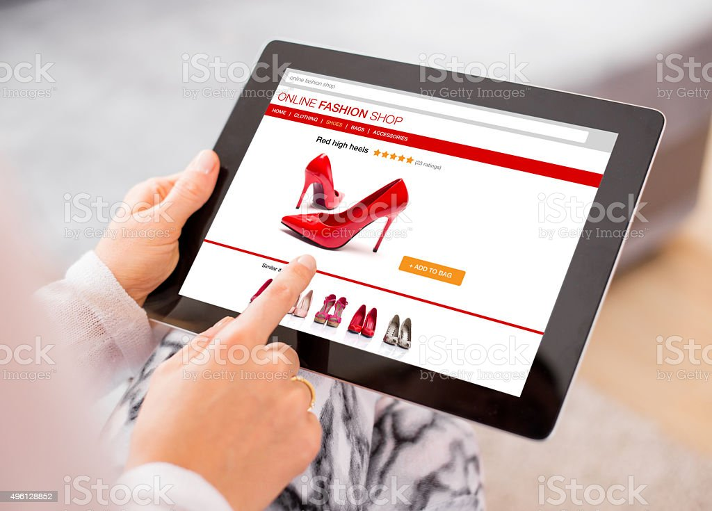 Woman using digital tablet to shop online stock photo