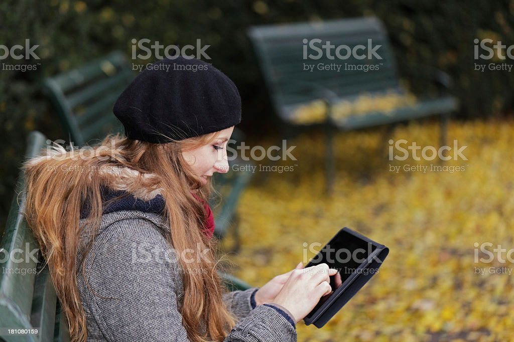 woman using electronic tablet outdoors royalty-free stock photo