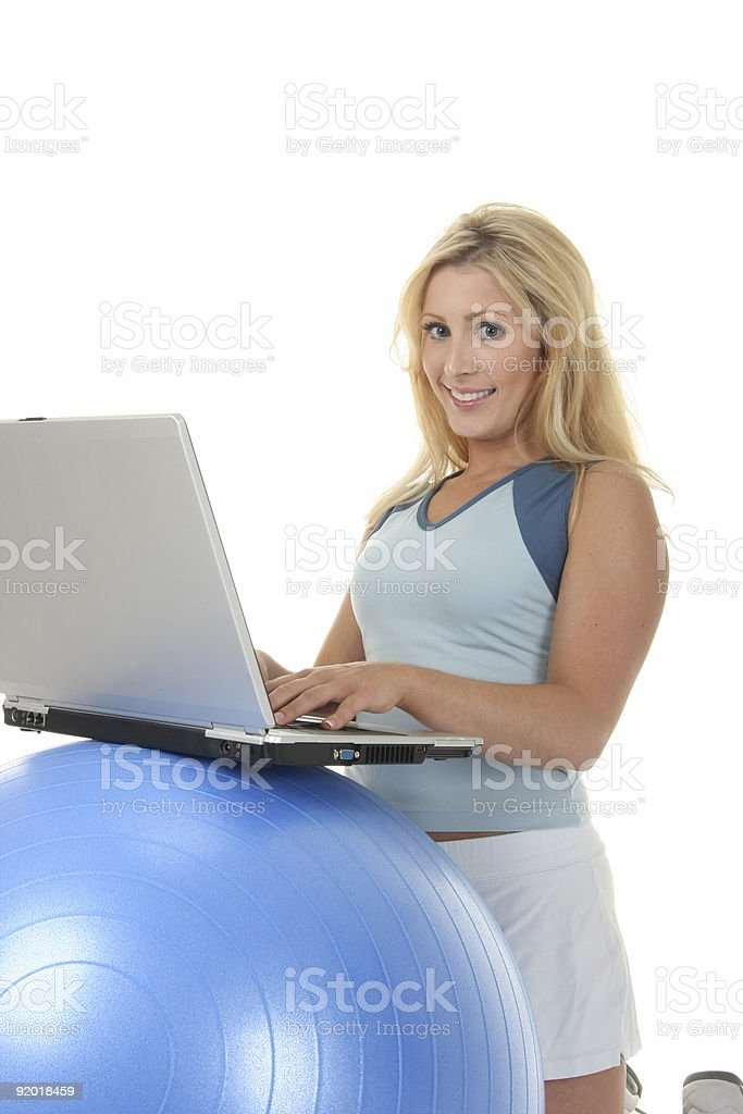 Woman Using Exercise Ball As Desk royalty-free stock photo