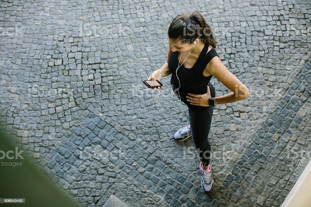 Woman using fitness app to monitor her progress stock photo