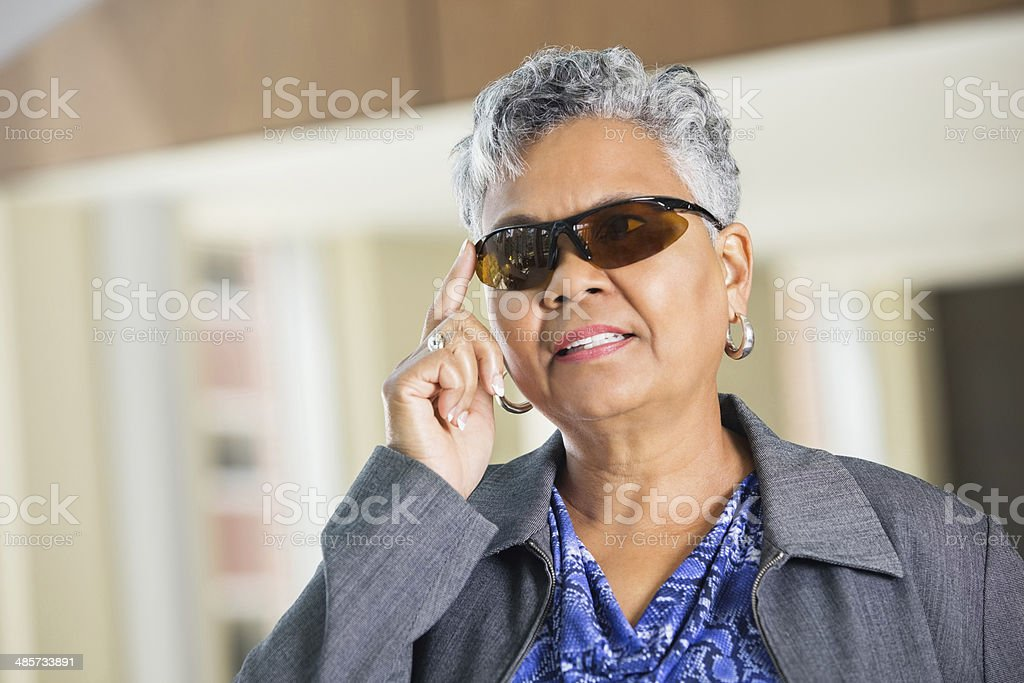 Woman using futuristic glasses stock photo