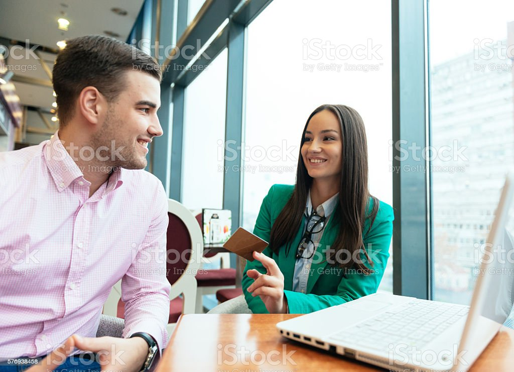 Woman using gold credit card for e-commerce stock photo