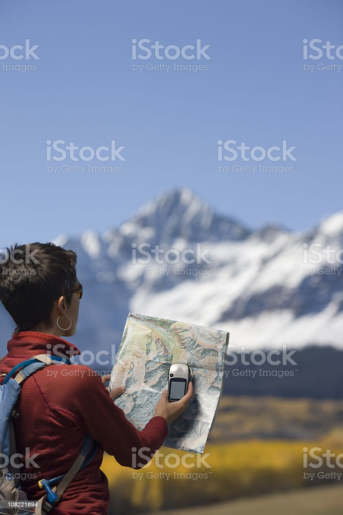 Woman using GPS royalty-free stock photo