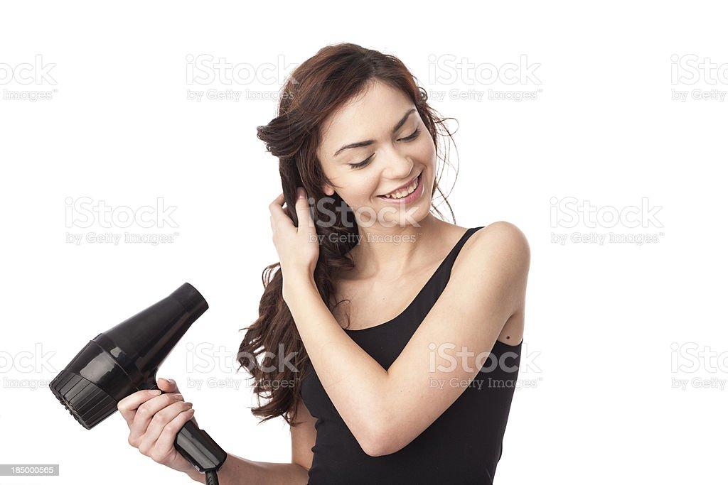 woman using hair drayer stock photo