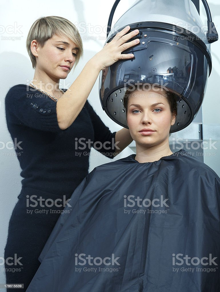 woman using hair dryer royalty-free stock photo
