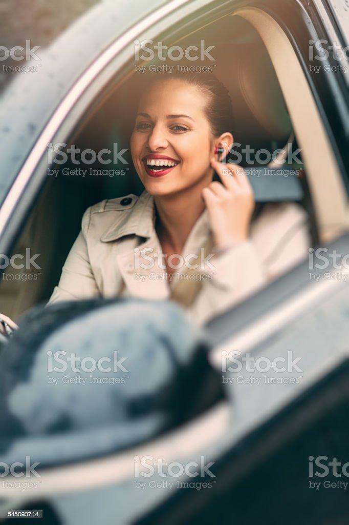 Woman using handsfree stock photo