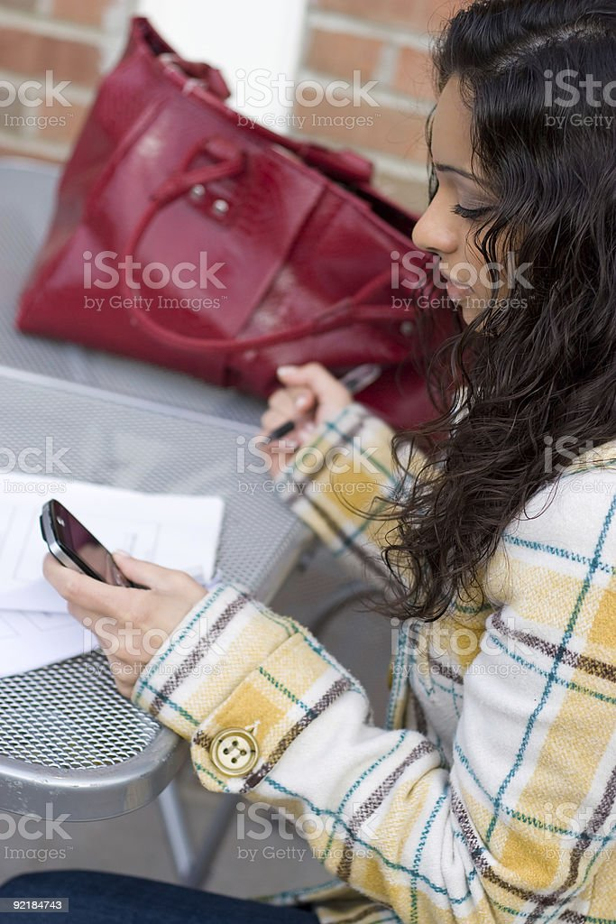 Woman Using Her Smartphone royalty-free stock photo