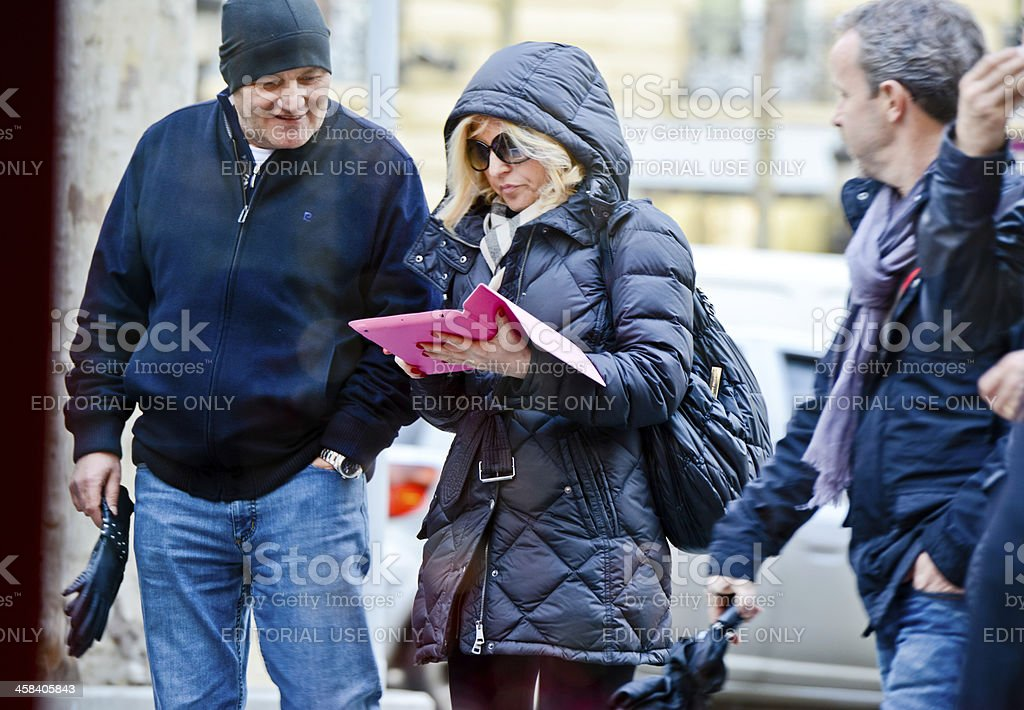 Woman using iPad on Paris Street royalty-free stock photo