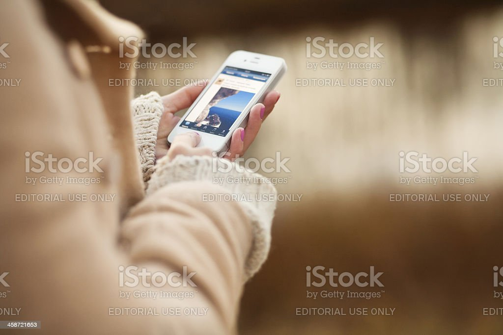 Woman using iPhone royalty-free stock photo