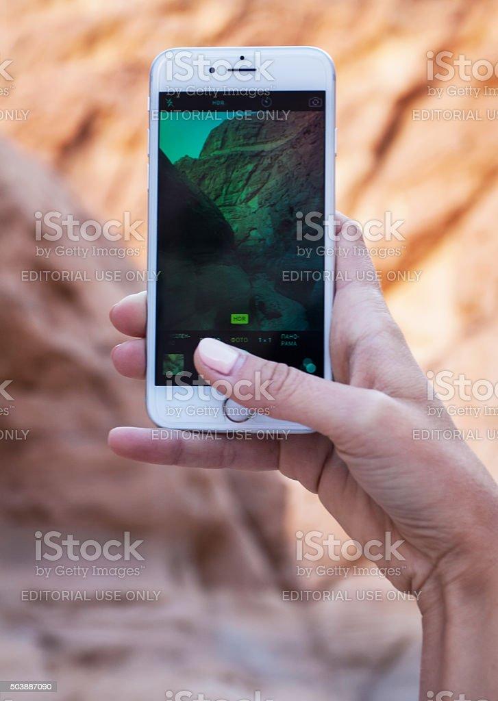 Woman using iPhone stock photo