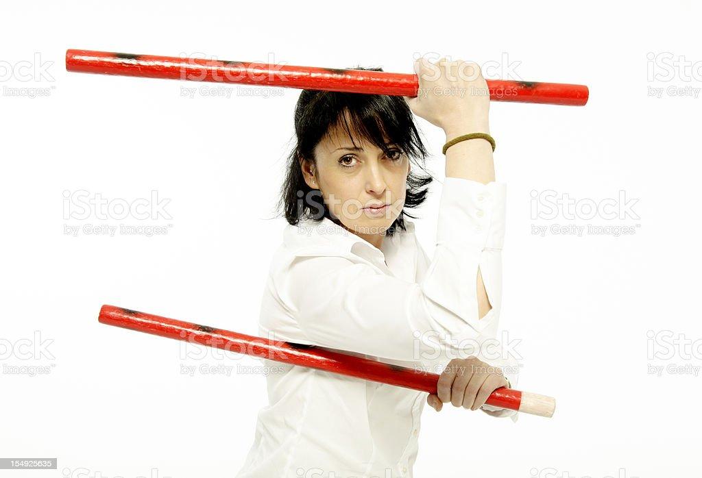 Woman using kombatant sticks stock photo