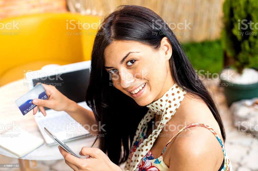 woman using laptop and credit card stock photo