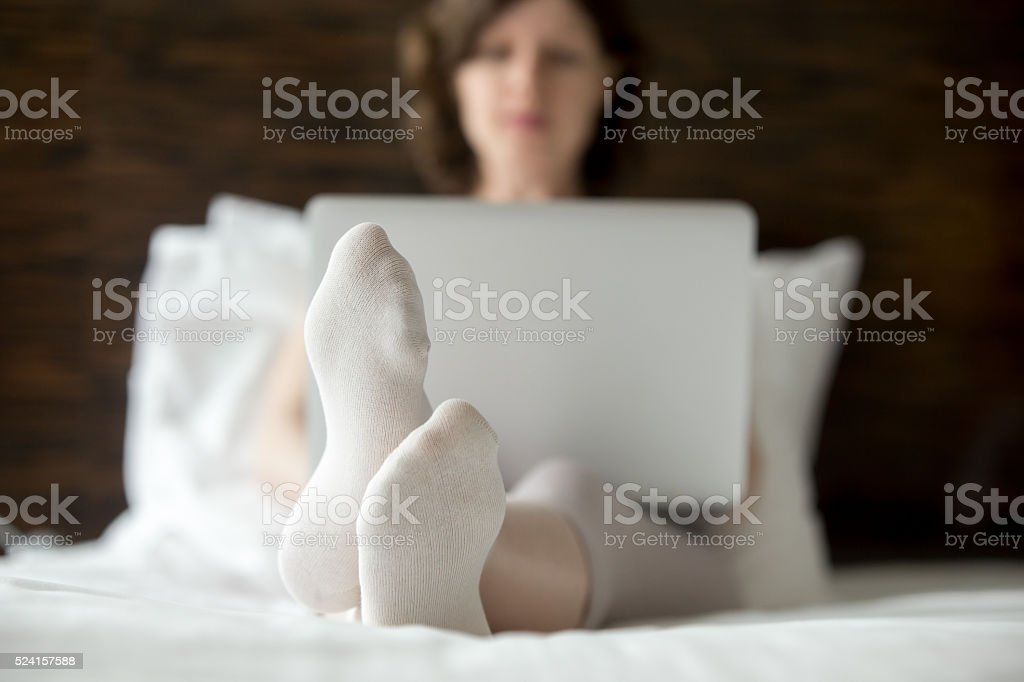 Woman using laptop at home stock photo