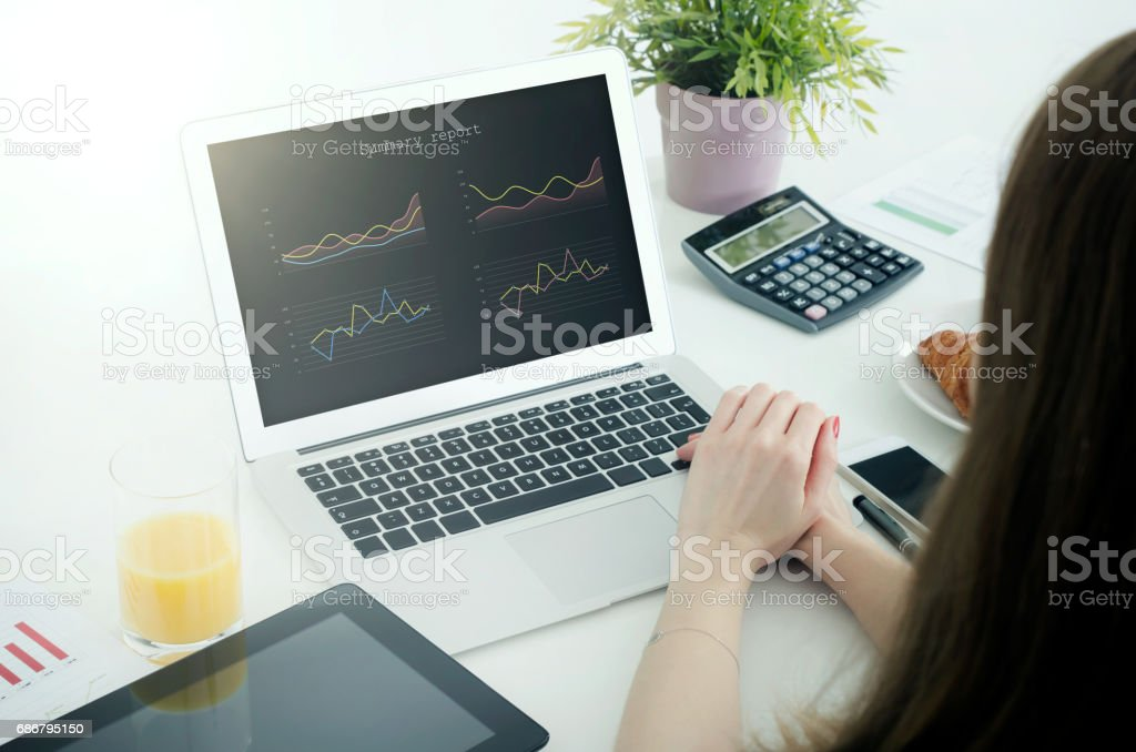 Woman using laptop in home. stock photo