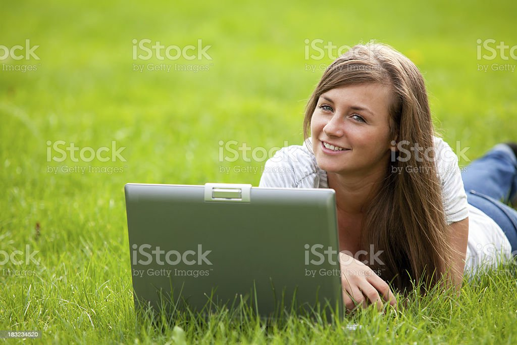 woman using laptop in park royalty-free stock photo
