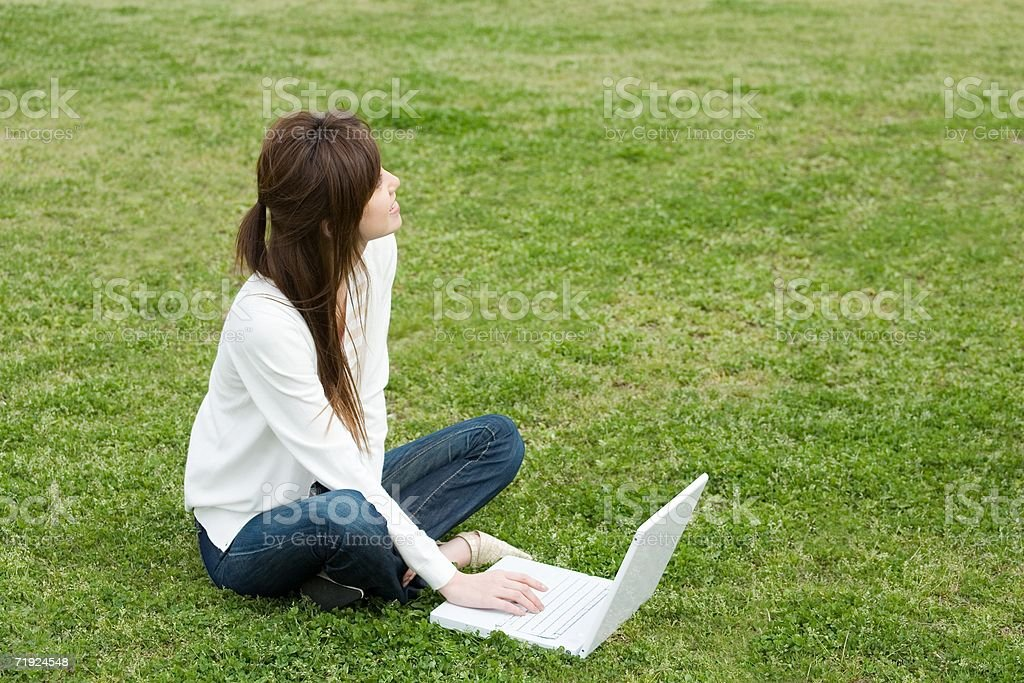 Woman using laptop outdoors royalty-free stock photo