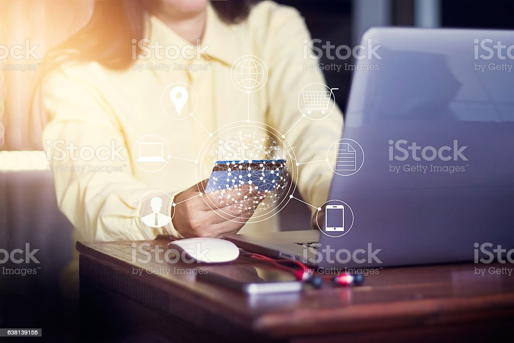 Woman using laptop payments online shopping and icon customer stock photo