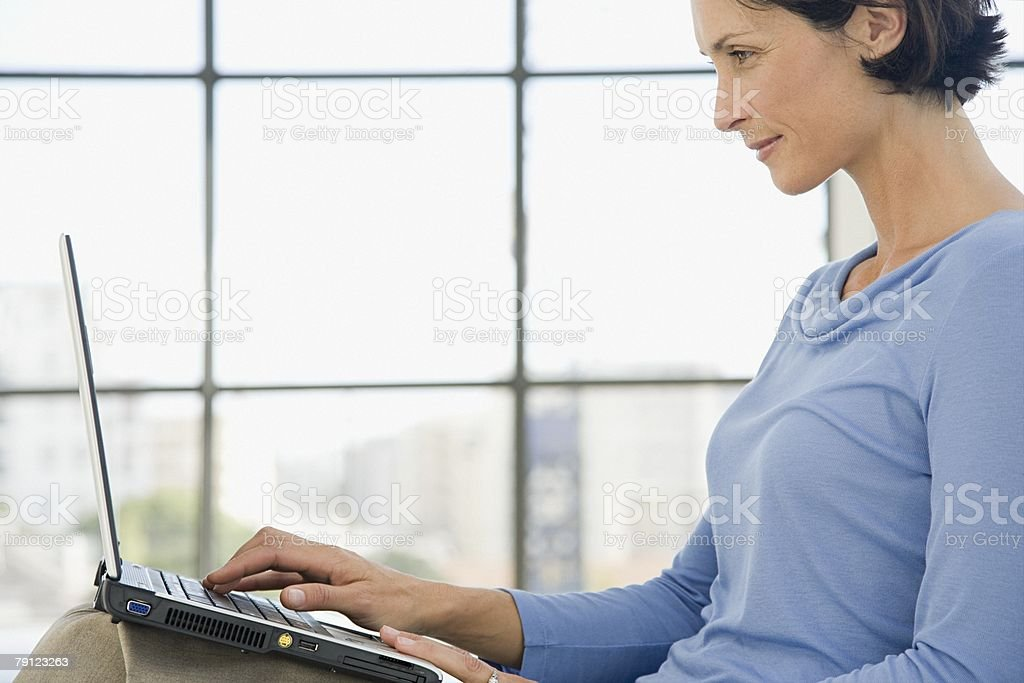 Woman using laptop royalty-free stock photo