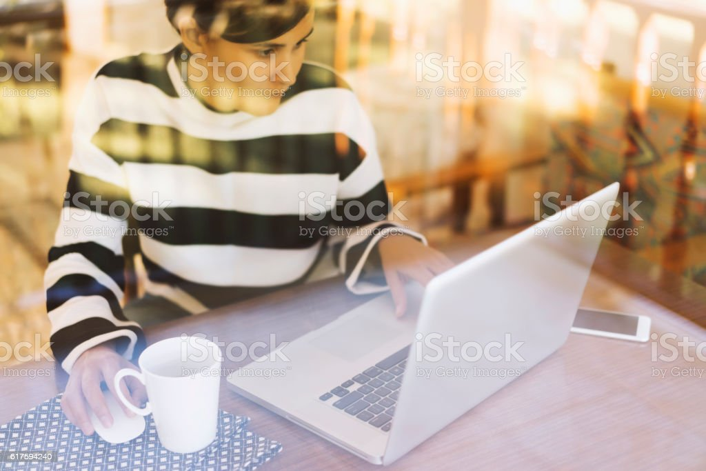 Woman using laptop, working home office stock photo