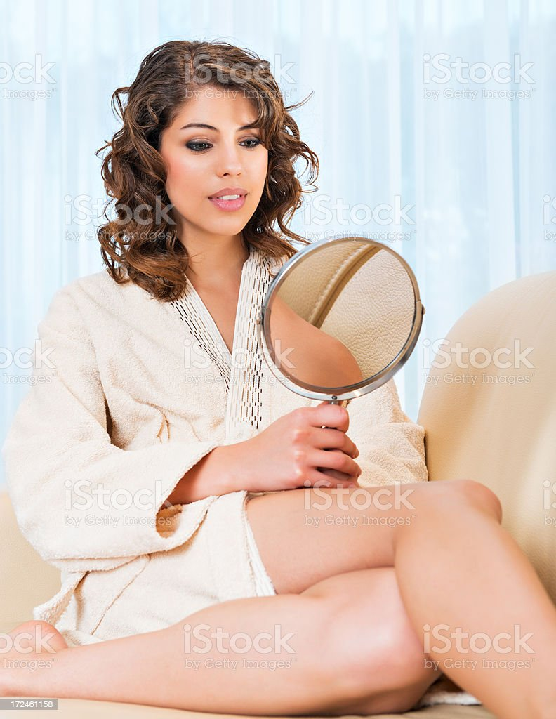 Woman Using Makeup Mirror royalty-free stock photo
