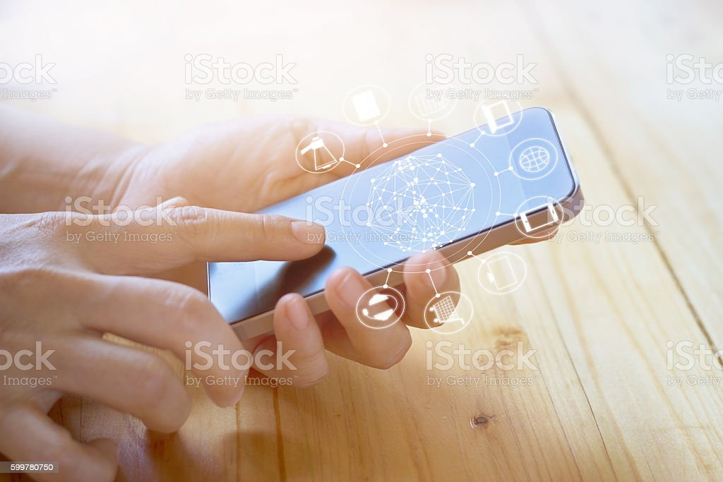 woman using mobile payments, holding circle global stock photo