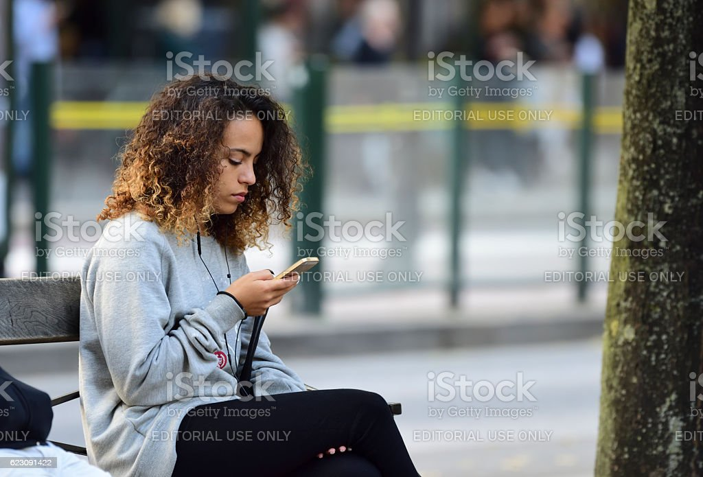 Woman using mobile smart phone stock photo