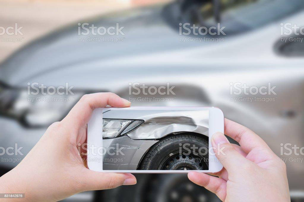 woman using mobile smartphone take photo car crash accident stock photo