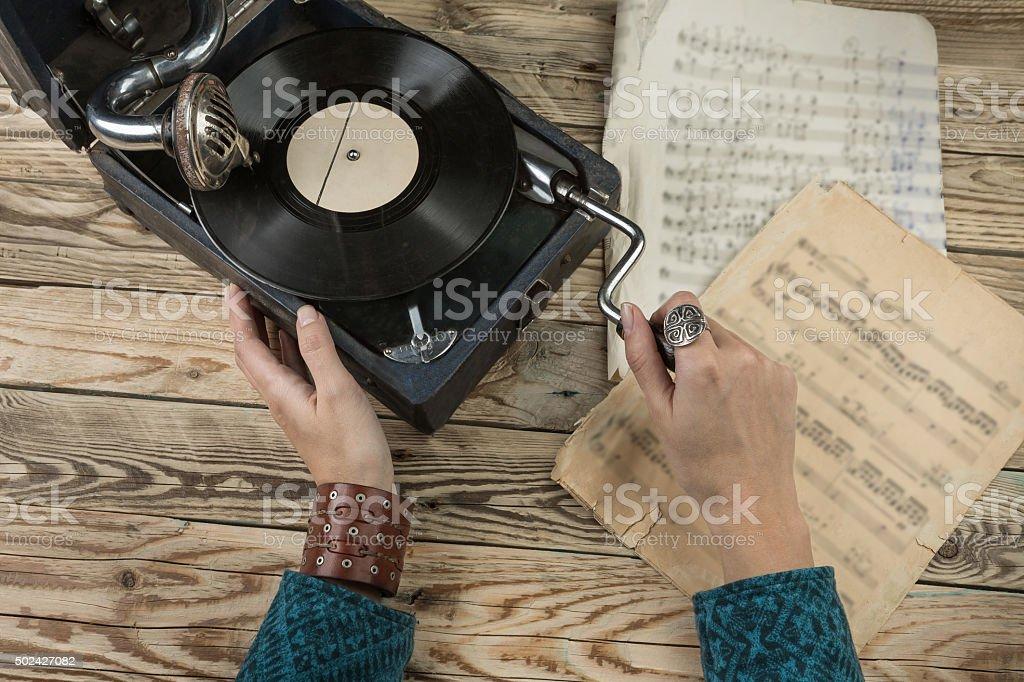 Woman using old gramophone stock photo